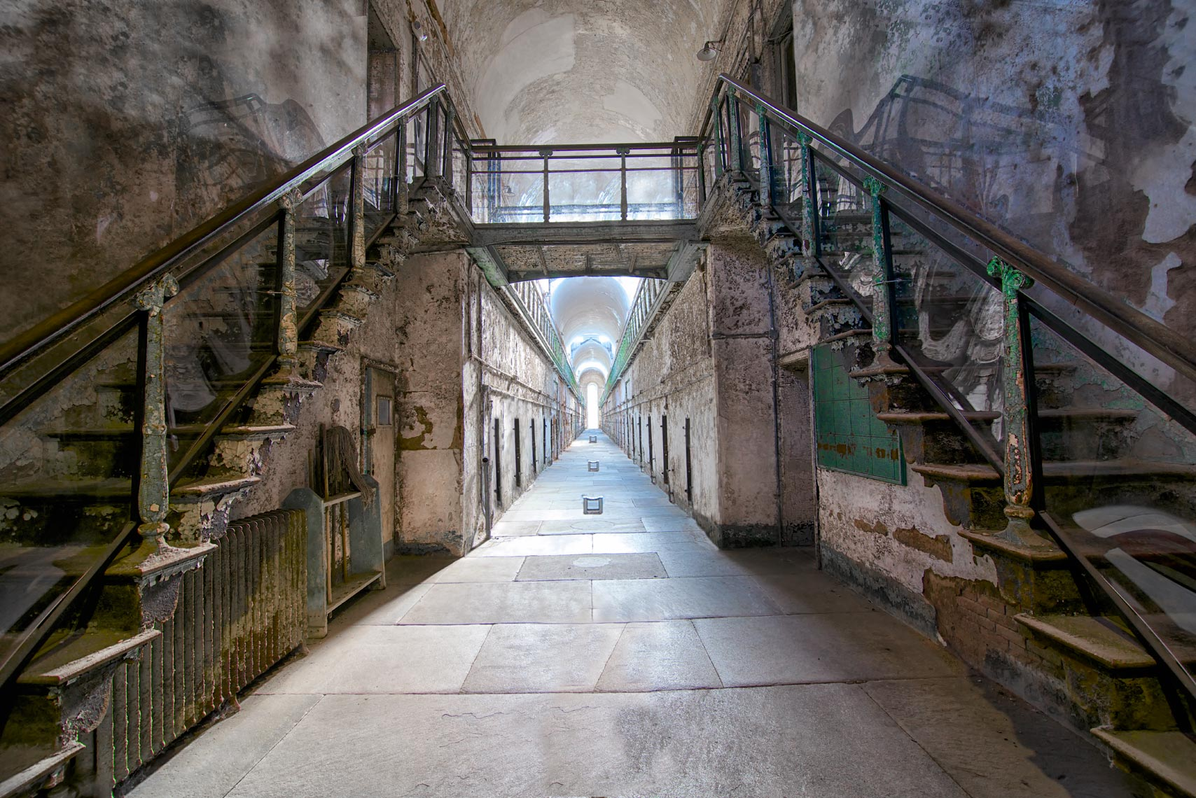 eastern state penitentiary stairway stairs hallway prison cells locker rooms prison house grey green blue black